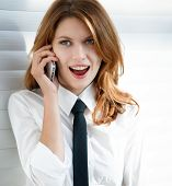 picture of button down shirt  - talkative woman in a white button down shirt with black tie - JPG