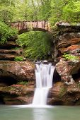 picture of cave  - A picturesque stone footbridge cross over the Upper Falls at Old Man - JPG
