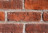 stock photo of mortar-joint  - An old wall is comprised of brick showing weathered texture - JPG