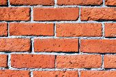 foto of mortar-joint  - An old wall is constructed of orange red clay bricks showing a rustic and worn texture - JPG
