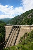 foto of hydroelectric  - Hydroelectric equipment concrete dam wall on clouds sky background - JPG
