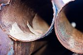 picture of orifice  - Closeup of the rusty metal pipes orifices.