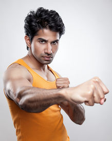 pic of knockout  - Handsome Indian man giving a knockout punch