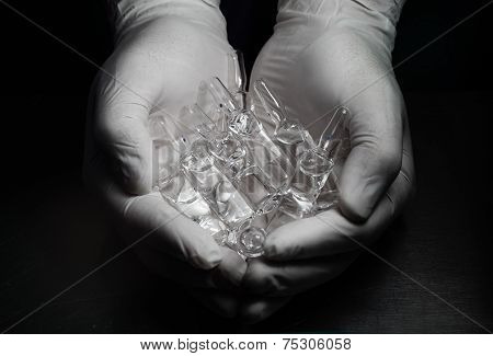 Ampules In Hands. Concept.