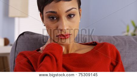 Sad Black Woman Sitting On Couch