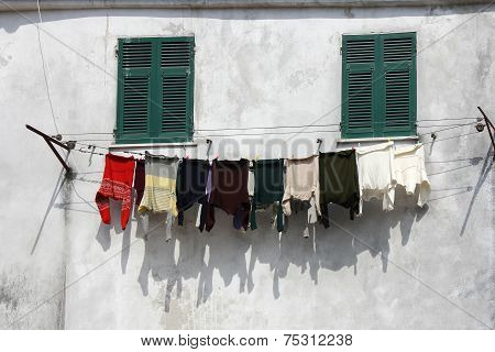 Drying Clothes On The Wall