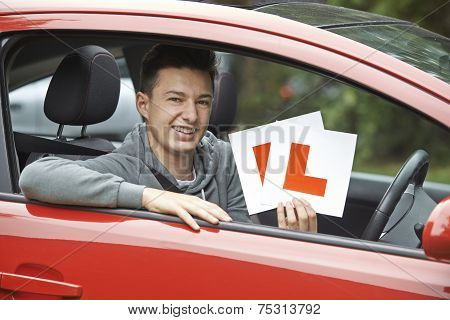 Smiling Teenage Boy In Car Passing Driving Exam