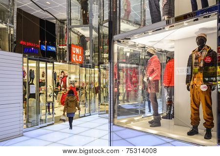 TOKYO, JAPAN - DECEMBER 29, 2012: UNIQLO clothing store in Tokyo. The fashion retailer is headquartered in Tokyo with hundreds of store locations in over a dozen countries.