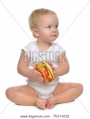 Fast Food Concept. Infant Child Baby Toddler Hold Tasty Unhealthy Burger