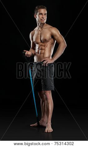 Muscular Bodybuilder Guy Doing Exercises With Expander
