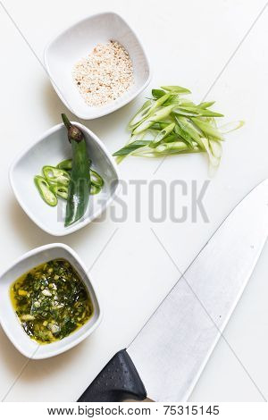 Sesame Seeds, Pesto Sauce And Freshly Cut Chillies