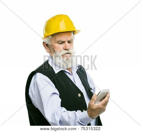 Senior manual worker with mobile phone isolated