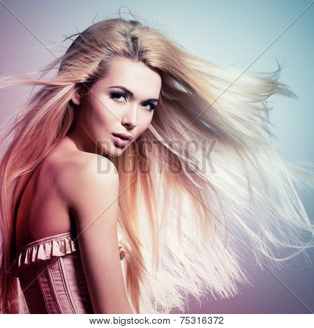 Portrait of the beautiful sexy woman with long blonde hair. Concept image is in tinting colorize style
