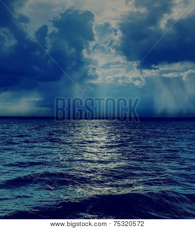 dramatic sky with clouds over dark sea
