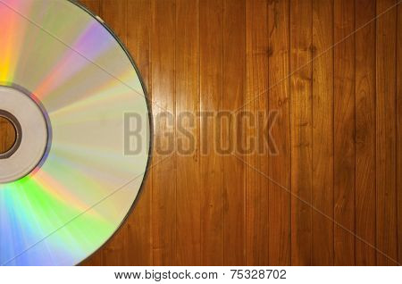 Compact Disc On A Wooden Background