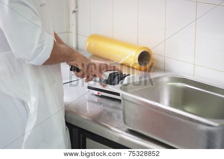 image of a cook sharpens a knife