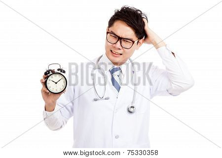 Asian Male Doctor In Bad Mood With A Clock