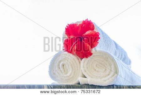 rolled beach or spa towels isolated over background