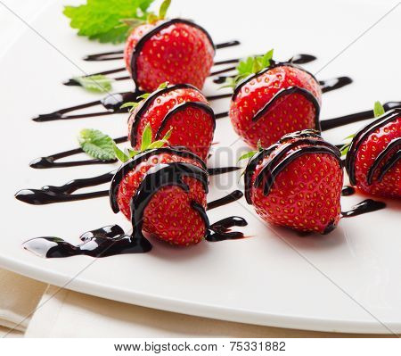 Fresh Strawberries Dipped In Chocolate Sauce