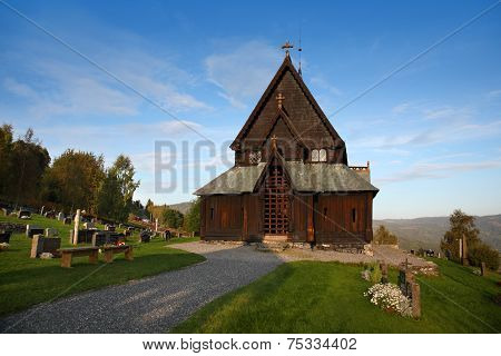 Front view of Reinli stave church, Sør-Aurdal, Norway, on a clear, bright sky