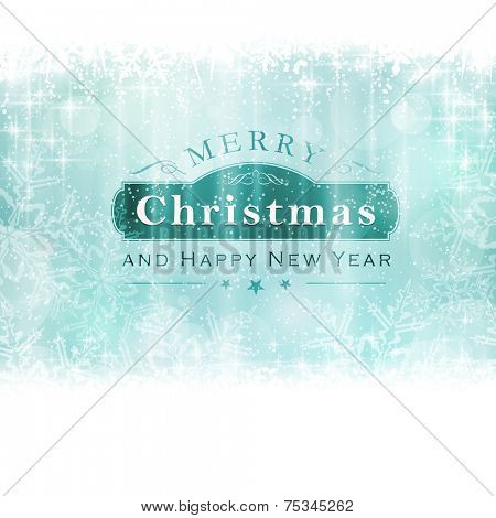 Christmas background with light effects and blurry light dots in shades of winter blue greens and white. Centered is a label with the lettering Merry Christmas and Happy New Year.