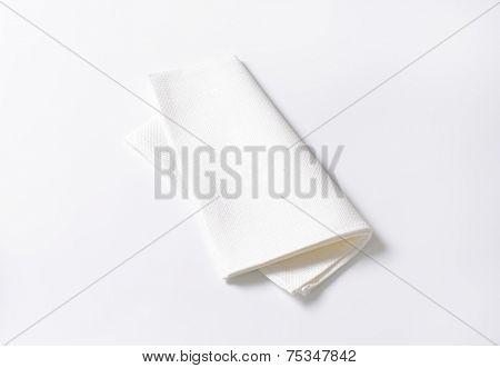 folded white napkin on white background