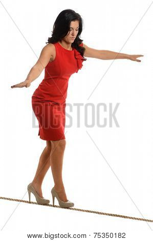 Young businesswoman walking on tightrope isolated over white background