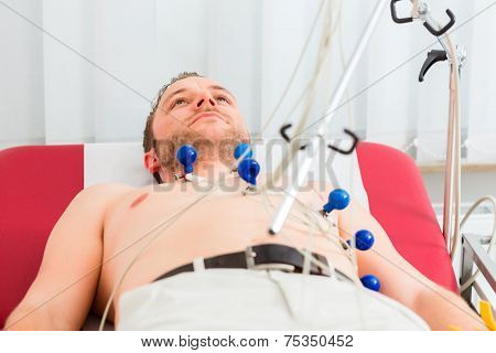Male patient having ECG electrocardiogram in hospital