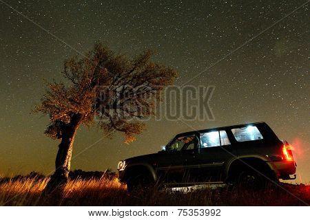 Night landscape on field and terrain car