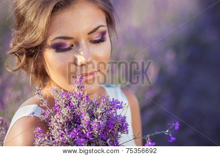 Beautiful girl on a field of lavender.