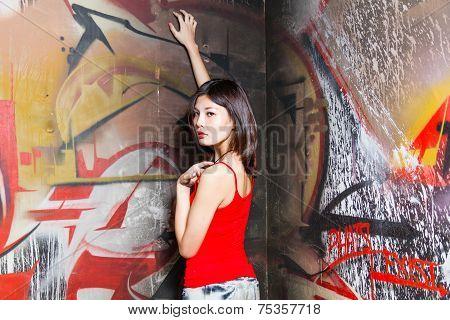 Beautiful Chinese woman by wall
