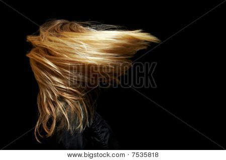 Woman With Long Hair In Wind