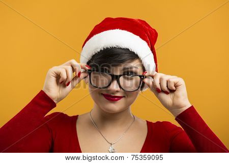 Beautiful and sexy girl wearing santa clause hat