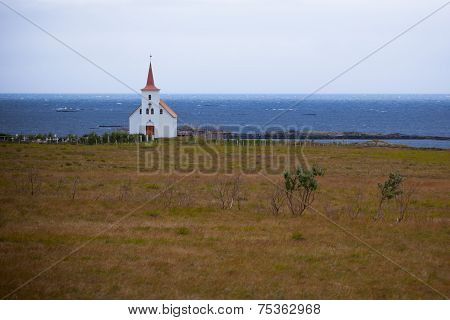 Typical Rural Icelandic Church At Overcast Day