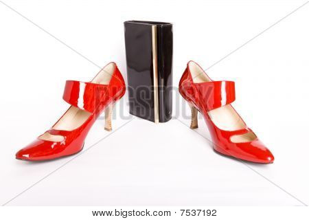 new elegant Shoes on a high heel and varnished leather handbag