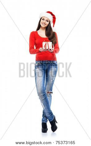 Young and attractive teenager girl with a Christmas present isolated on white background