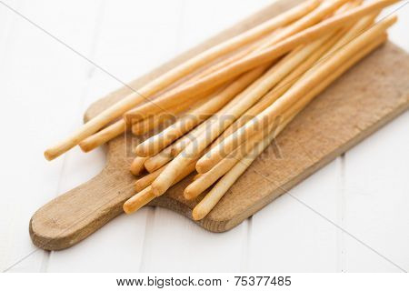 breadsticks grissini on cutting board
