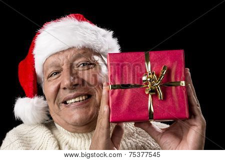 Smiling Old Man With Red Wrapped Christmas Gift