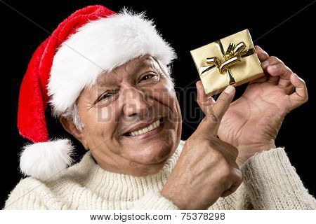 Playful Male Pensioner Pointing At Golden Gift