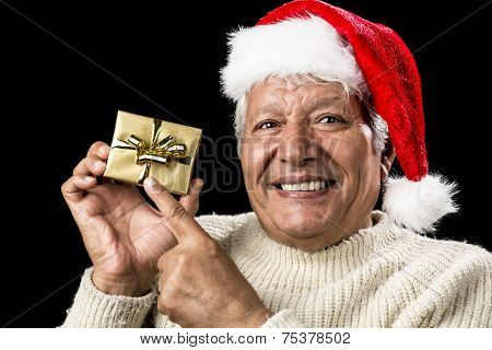 Joyful Old Man Gesturing At Wrapped Golden Gift