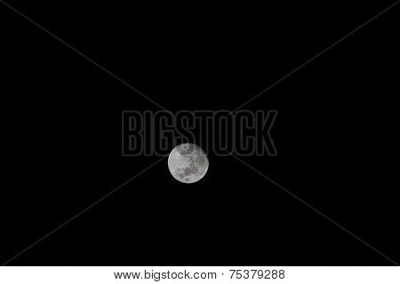 The moon,the Earths natural satellite smiling in the darkness of night