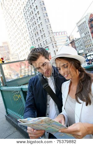 Couple looking at city map by the Flatiron buidling, NYC