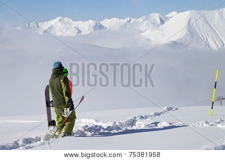 Snowboarders On Off-piste Slope With New Fallen Snow