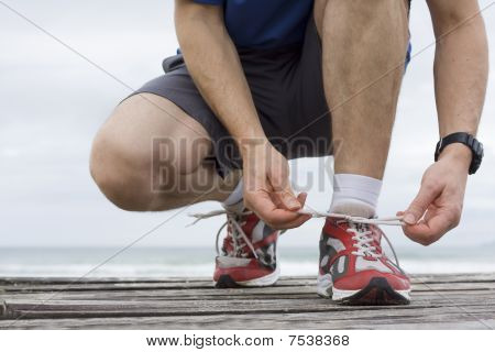 Runner Tying Shoelace