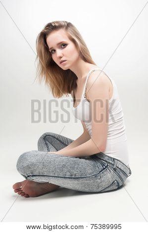Attractive sad woman on floor