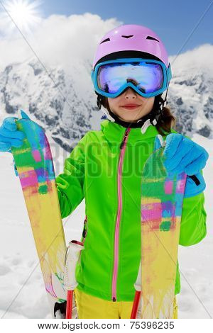 Ski, skier, winter fun - lovely skier girl enjoying ski vacation