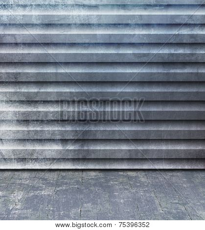 Grunge room with blue gray corrugated steel wall and old floorboard - abstract industry background with container texture