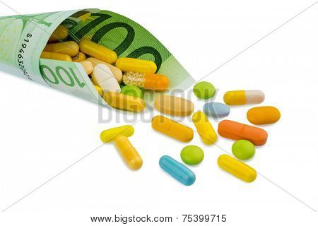 tablets and one hundred euro banknote symbolic photo: costs for medicine and drugs the pharmaceutical industry