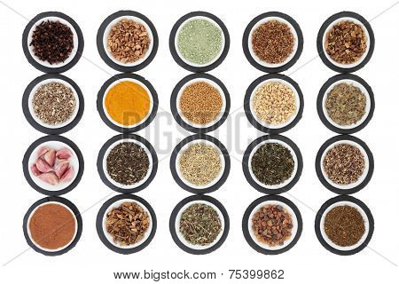 Liver detox health food selection in porcelain dishes on slate rounds and over white background.