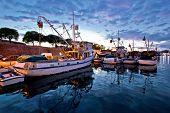 picture of fleet  - Fishing boats on colorful sunset in Zadar Croatia - JPG